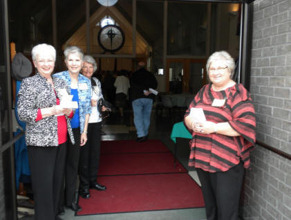 L to R: Sheila Morgan, Judy Morgan, Joyce Haygood, and Karen Brown are welcoming guests to the program.