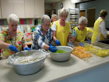 Preparing the lunch are sisters Betty, Lenore, Sue, Tag, Lillian, and Carol