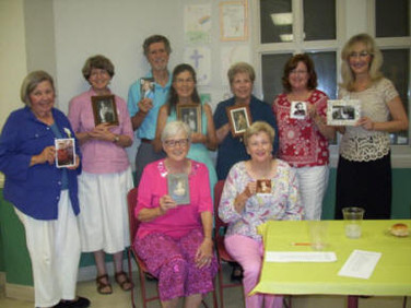 """Members of Chapter E, Auburn, held a """"From Mama's Kitchen"""" BIL dinner."""
