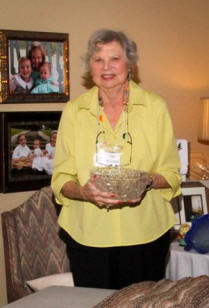 Auctioneer Sue McLean holds a lead crystal bowl to be auctioned.