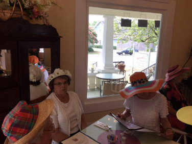 Bettye Dennis, Mary Lou Rose, and Marilyn Mooneyham are reviewing the menu.