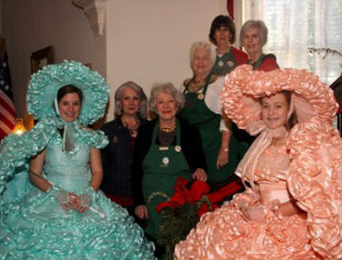 Surrounded by lovely Azalea Trail Maids are Wendy James, Paula Johnson, Judy Tyler, Betsy Gerthoffer, and Susan Tomlinson who prepared and served the luncheon.