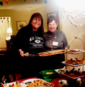 Becky Jones and Marilyn Kaup enjoy the delicious Christmas treats at the December meeting.