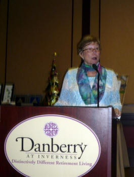 Julie Breeden explains the P.E.O. philanthropies and fundraising at the Tea & Auction.
