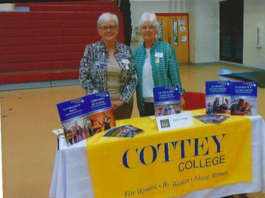 Julia Norton and Dani Halverson, both of Chapter E, manned the Cottey College table for the College Fair at Loachapoka High School in November.