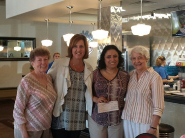 Ghada Almadi receives her PCE grant for $1800 from Chapter J members at our August breakfast.  Pictured are Marianne Stevens, Nancy Gauldin, Ghada, and PCE chair Nell Roberts.