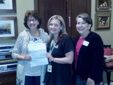 Susan Hargrave presents a PCE check to Colleen Craft who is attending Virginia College as Elise Hicks looks on.