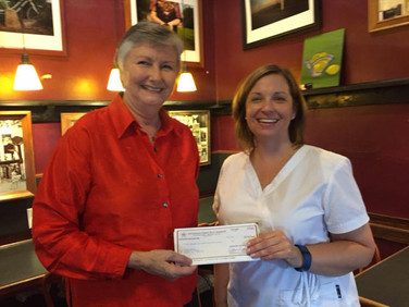 Judy Weaver, PCE Committee,  presents a PCE check to Cynthia Maier.   Congratulations to Chapter C and to Cynthia.