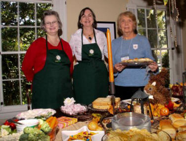 Marilyn Cepeda, Jain Ann Lane, and Sally Czepiel prepare  and serve food at the auction luncheon.