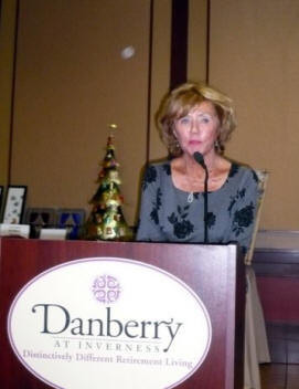 Char Bonsack, Chapter B President, welcomes guests at the Tea & Auction.