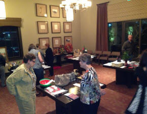Members are viewing and making silent bids on auction items.