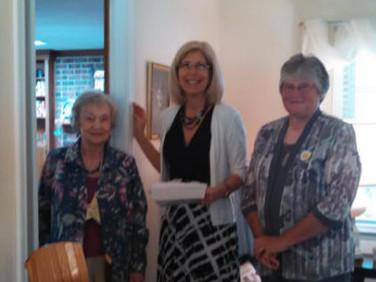 Debbie Della Silva, Chapter M president, presenting 50 year pins to Nadean Hankins and Martha Woodworth.