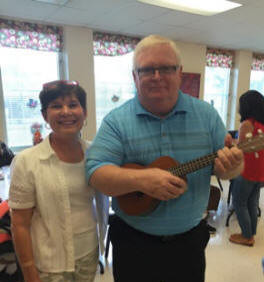"Ann Patton and her BIL, Barry -  providing a ""little entertainment""  with his ukulele"