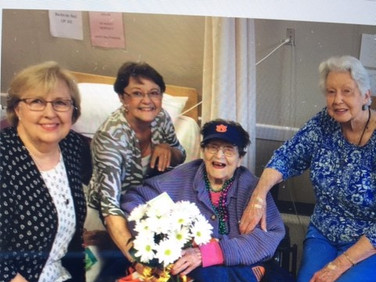 Members of Chapter AJ, Gloria McHugh, Mary Wiley and Betty Drake, celebrate with Eunice Hutchinson on her 101st birthday.