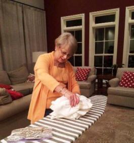 Rita Reese ironing napkins