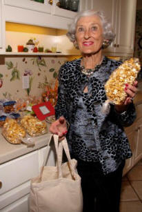 Mary Jane Coleman displays her homemade caramel popcorn.