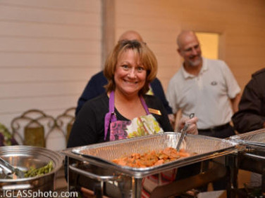 Kathy Christy, serving at the buffet