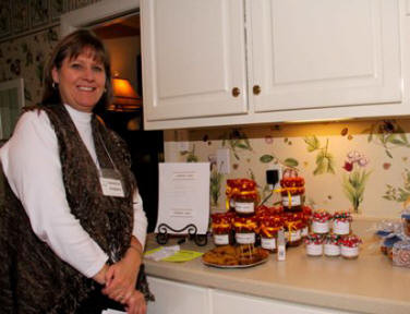Sandy Stepan prepares to purchase pumpkin cake in a jar,  homemade relish, or the peanut brittle.