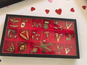 "Pam Lacey, Ch AM, presented the perfect Valentine's Day program: ""World War II Sweetheart and Son in Service Memorabilia"". She showed us a small part of her collection and shared the history and stories about the various pieces."
