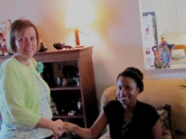 Chapter Q's newest member, Debbie Gardener greets Sharetha Hayden