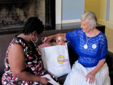 Sarita and Sara discussing the gift bag.