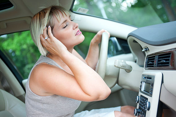 Effects Of Hot Weather On Your Car Woman Using Car Cooling