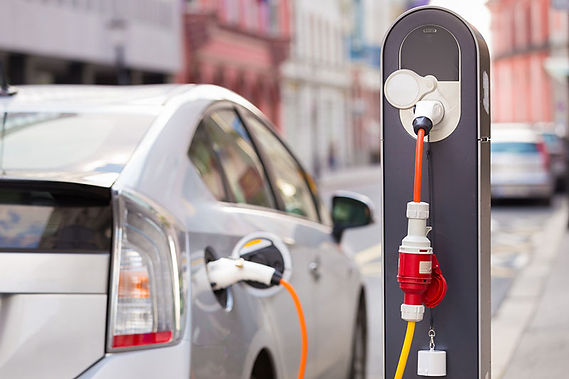 electric car plugged in, buying an electric car, how electric cars work, how do hybrid electric cars work, how do plug in hybrid electric cars work, how do fuel cell electric cars work, how to choose an electric car, is an electric car right for me