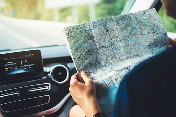 man in car with map,  road trip movies, movies about road trips,movies to stream, classic road trip movies
