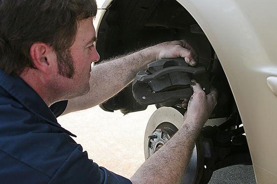 Cheapest Brake Pads Mechanic Changing Brake Pads, cheapest brake pads, best brake pads, which brake pads should I buy, smart brake pads, choose brake pads