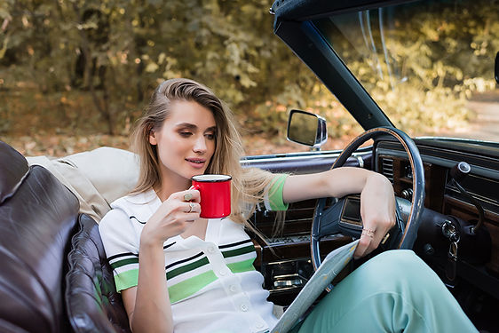 woman reading map on car, driving mistakes that ruin your car, mistakes that ruin automatic transmission, automatic transmission mistakes, mistakes ruining your car, ruin automatic transmission