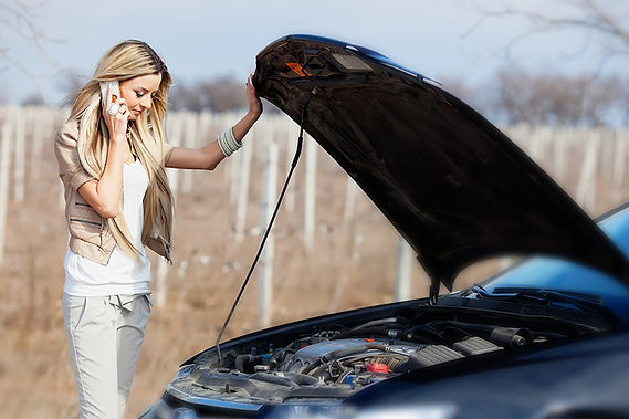 woman with broken car, driving mistakes that ruin your car, mistakes that ruin automatic transmission, automatic transmission mistakes, mistakes ruining your car, ruin automatic transmission