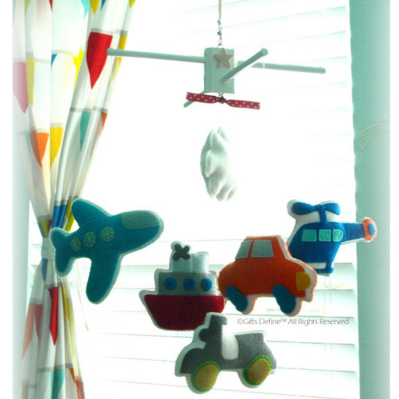 Vibrant color baby mobile decor featuring Travel and Transportation theme