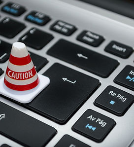 white-caution-cone-on-keyboard-211151.jp