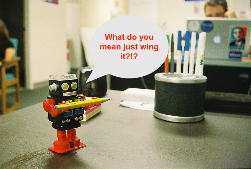"""Copywriting robot holding a pencil and asking: """"What do you mean just wing it?"""""""