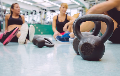 Closeup of black iron kettlebell and peo