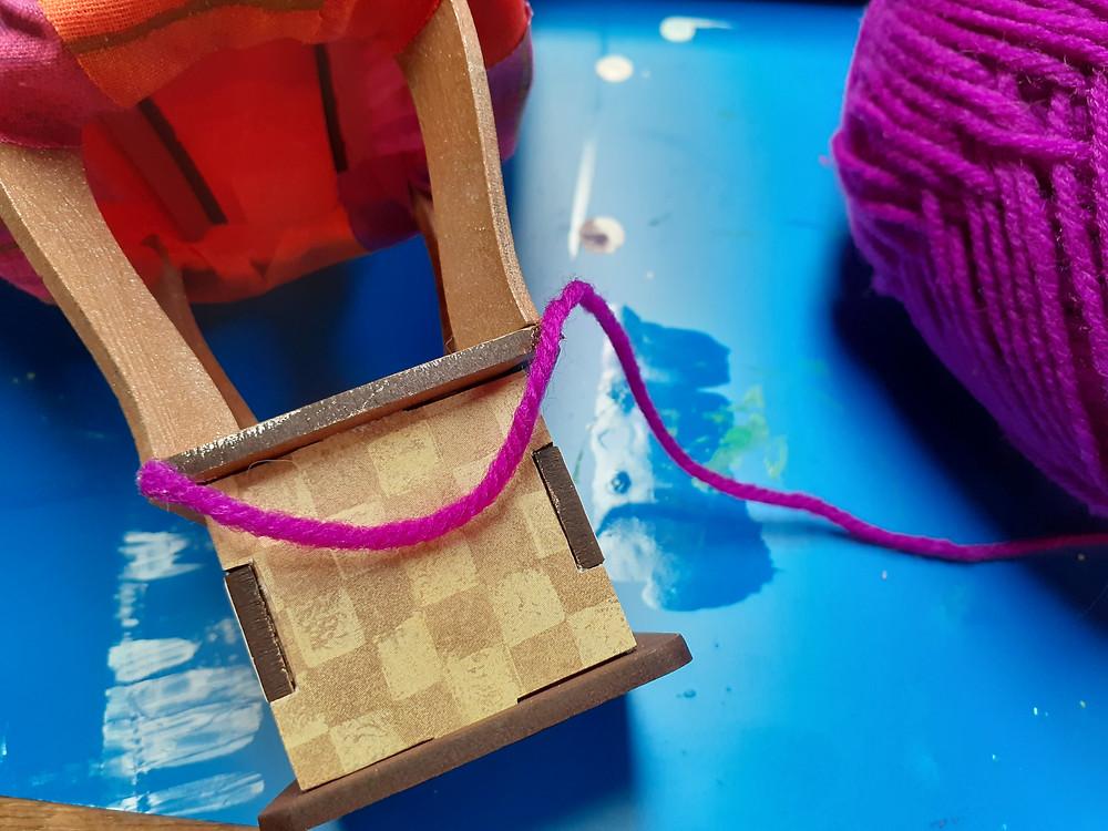 Gluing a 'rope' festoon onto hot air balloon