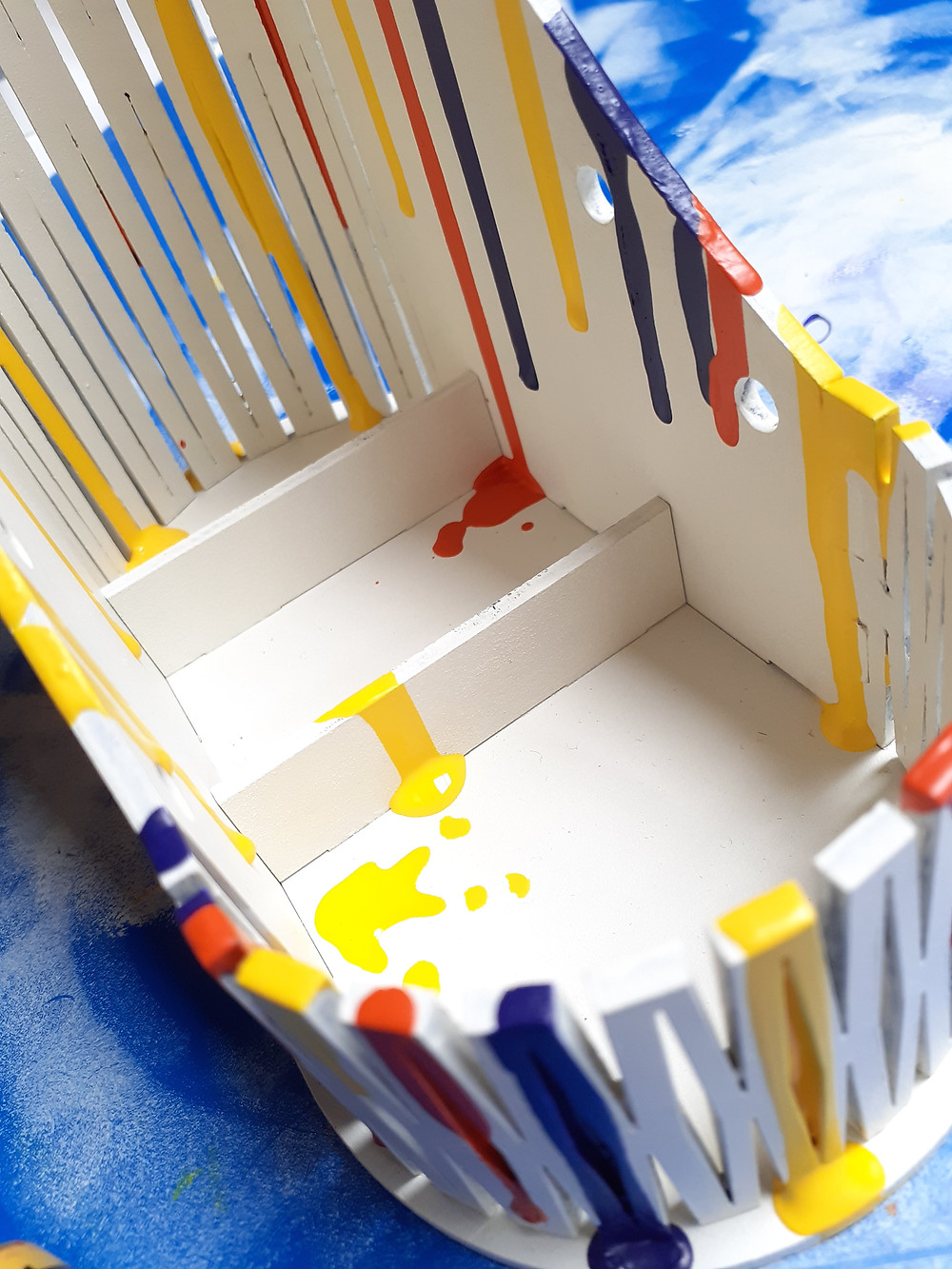 MDF boot with primary colour paint drips