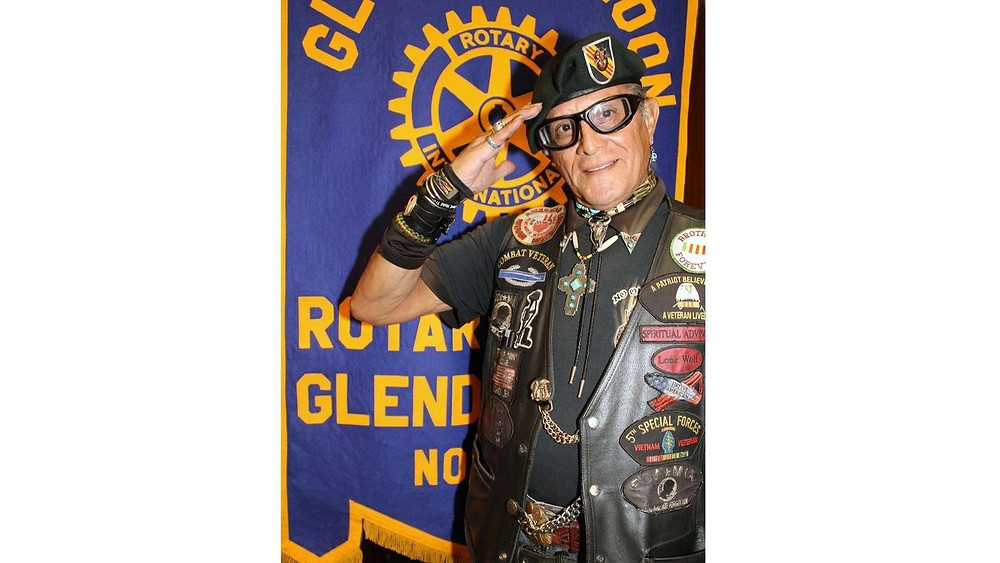 "Albert Lynn ""Lone Wolf"" Boles smartly salutes the flag as he leads Glendale Noon Rotary members in the Pledge of Allegiance. (Ruth Sowby Rands / Glendale News-Press)"
