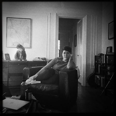 Jean Ann Douglass in her living room, with her cat, Zeus