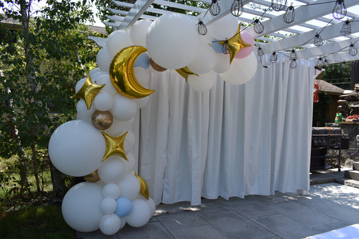 Gender Reveal Balloons in an Organic Balloon Garland by Eye Candy Balloons
