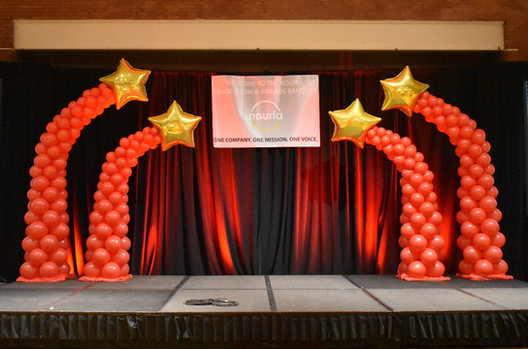 Corporate Event Balloon Columns on Stage | Eye Candy Balloons