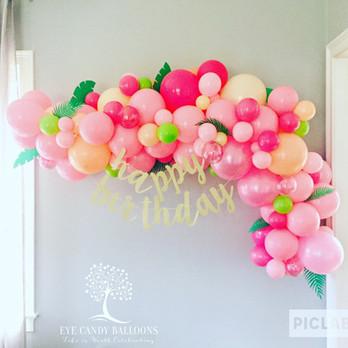 Moana Birthday Balloons in an Organic Balloon Garland by Eye Candy Balloons