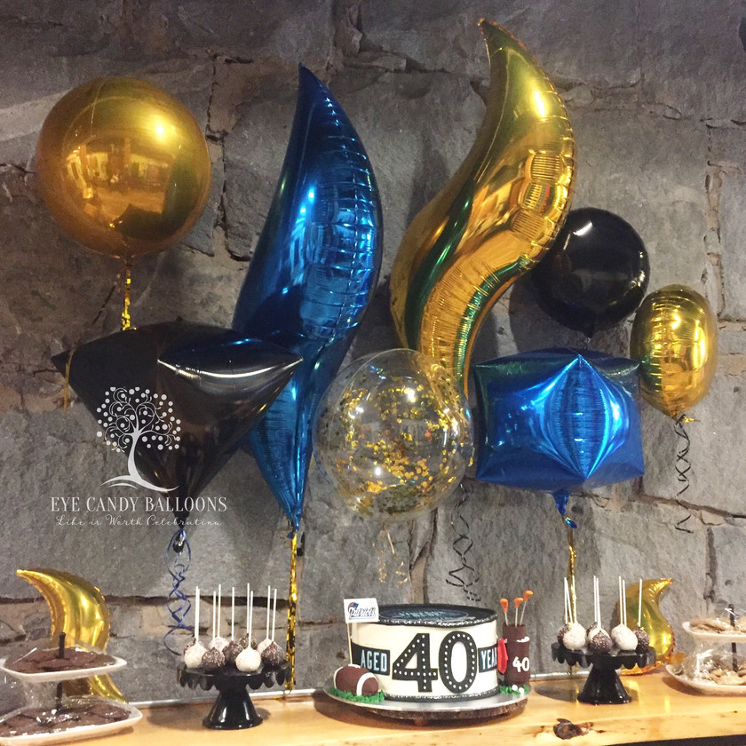Latex-free balloon centerpieces, balloon backdrop - Eye Candy Balloons