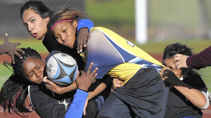 Rowe-Clark's Shanya Jones is brought down by Pritzker's Taylor Jackson, left, during their championship rugby game at Altgeld Park. (Nuccio DiNuzzo / Chicago Tribune)