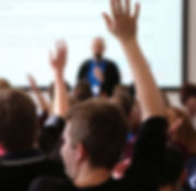 104678943-Raising_Hands_During_Seminar.1