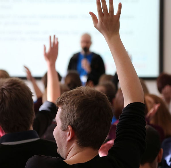 104678943-Raising_Hands_During_Seminar.1