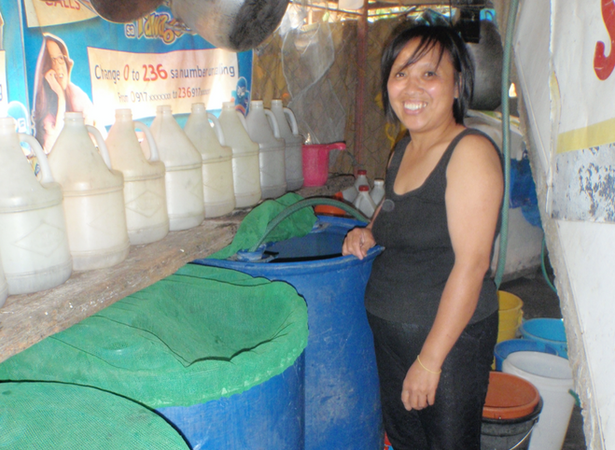 Covering_water_to_prevent_dengue,_Baguio