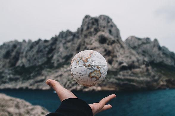 person-tossing-globe-1275393.jpg