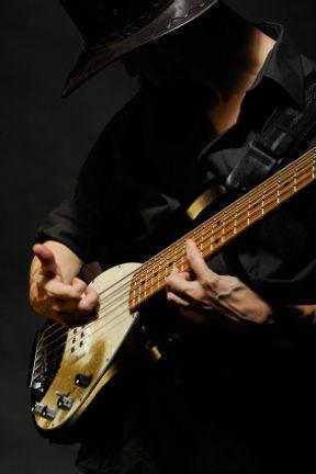 Beauty shot man playing bass