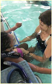Caregiver with child in pool 2.png